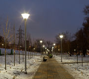 Evening lighting in park. Street lamps. Russia, Moscow Royalty Free Stock Photo