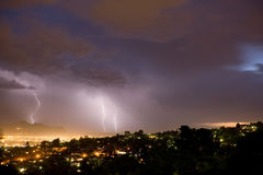 Evening Lightning Bolts. Spectacular hillside view across the city of an early evening thunderstorm and lightning bolts in Somerset West, South Africa stock photos