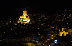 Evening lights ander the Tbilisi. Evening lights ander the churge of  Holy Trinity. 29 March 2013, Tbilisi, Georgia Royalty Free Stock Photography