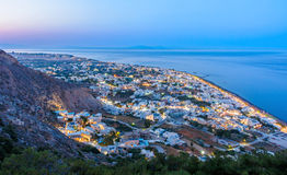 Evening lights of Kamari, Santorini Stock Images