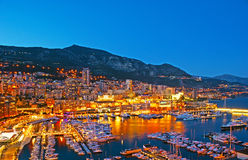The evening lights of Monaco. Panorama of the Hercules Port with the yachts and boats, surrounded by thousands of city lights, reflected in water, Monaco stock photos