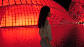 City of Arts and Sciences Valencia Spain in the evening. Young girl.