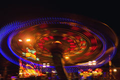 Evening lights rotating swing Stock Photography