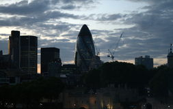 Evening London Sky Line Featuring the Gherkin Building. This is a late evening view of the London skyline, featuring several buildings including the iconic royalty free stock images