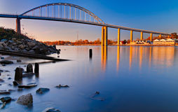 Evening long exposure of the bridge over the Chesapeake and Delaware Canal in Chesapeake City, Maryland.  Royalty Free Stock Images