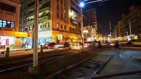 The evening in Mahta al Raml square, Alexandria. ALEXANDRIA, EGYPT - DECEMBER 17, 2017: The noisy evening in Mahta al Raml square, vintage trams ride from the stock video footage