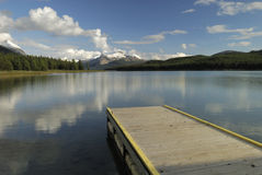 Evening at Maligne Lake in Canadian Rockies. Boat dock at Maligne Lake in Jasper National Park, Canada Royalty Free Stock Photo