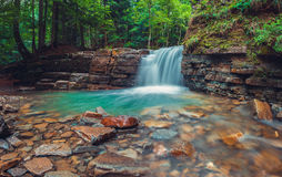 Evening Manyavsky waterfall in mountains, Ukraine. Royalty Free Stock Photo