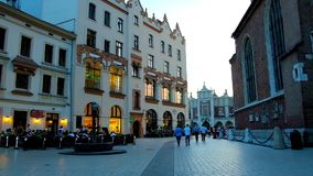 The evening Mariacki Square with old townhouse, Krakow, Poland stock video