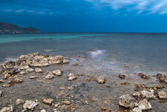 Evening Mediterranean coast on long exposure Royalty Free Stock Images