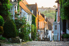 Evening in Mermaid Street, Rye, East Sussex, England. Beautiful evening light on Mermaid Street, Rye, East Sussex, England. The street has buildings dating back Royalty Free Stock Image