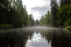 Evening mist to calm. A small river Royalty Free Stock Photo