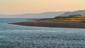 Exmouth, Devon, UK. Evening mood at Dawlish Warren and the river Exe. Seen from Exmouth, Devon, England, UK stock image