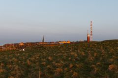Evening mood on Helgoland with lighthouse and church Stock Photos