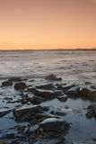 Evening mood at irish seashore. After sundown at donegal bay, county sligo, ireland Stock Photos