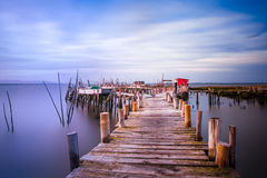 Evening mood over a jetty into the Sado river in Portugal Stock Images
