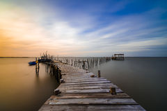 Evening mood over a jetty into the Sado river in Portugal Stock Photography