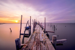 Evening mood over a jetty into the Sado river in Portugal Royalty Free Stock Photo