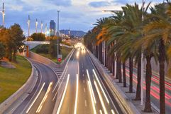 Evening motorway with palm trees Barcelona Spain stock images