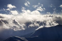 Evening mountain in haze and sunlight clouds Royalty Free Stock Photography
