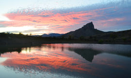 Evening mountain. The reflection of the sunset in the lake Royalty Free Stock Image