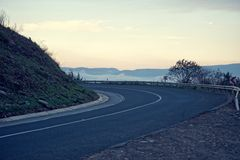 Evening mountain road Royalty Free Stock Photography