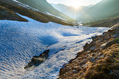 Evening mountain stream and sunset Royalty Free Stock Photo