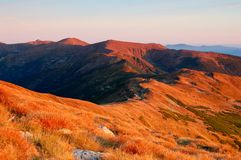Evening in mountains. Mountains Carpathians, Ukraine. The highest ridge of the Ukrainian Carpathians - Chernogora, more than 2000 metres. The picture is made in Royalty Free Stock Images