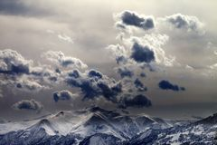 Evening mountains and cloudy sky Stock Images