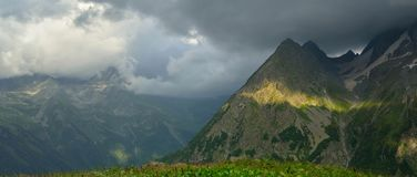 Evening in mountains. This is gloomy evening in Caucasus mountains in summer Stock Photos