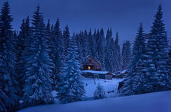 Evening in the mountains. A house in the Carpathians at dusk Royalty Free Stock Photos
