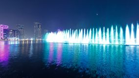 Evening Musical fountain show. Singing fountains in Sharjah timelapse, UAE. 4K royalty free stock images