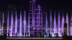 Evening Musical fountain show. Singing fountains in Sharjah timelapse, UAE. 4K royalty free stock photography