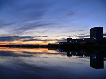 Evening Nadim on the river Nadym. Sunset over the city. Stock Images