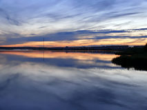 Evening Nadim on the river Nadym. Sunset over the city. Royalty Free Stock Photography
