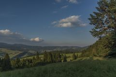 Evening in national park Pieniny with sunny shine over green meadows. And blue sky over heads stock photos