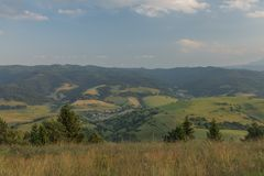 Evening in national park Pieniny with sunny shine over green meadows. And blue sky over heads royalty free stock photography
