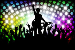 Evening in night club. people against color illumination Royalty Free Stock Photo
