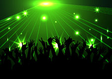 Evening in night club. people against color illumination Royalty Free Stock Image