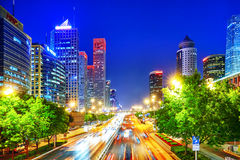 Evening, night modern Beijing. BEIJING, CHINA - MAY 20, 2015:Evening, night modern Beijing business quarter of the capital, the streets of the city with stock photography
