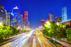 Evening, night modern Beijing. BEIJING, CHINA - MAY 20, 2015:Evening, night modern Beijing business quarter of the capital, the streets of the city with royalty free stock image