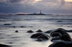 Evening by the Ocean. The Feistein lighthouse, Rogaland, North Sea, Norway Stock Images