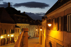 Evening in old town Sibiu. View from the passage near Journeymen`s House towards Tower Street Royalty Free Stock Photos