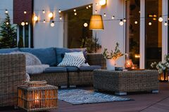 Free Evening On The Patio Of Beautiful Suburban House With Lights In The Garden Garden Stock Image - 189711961