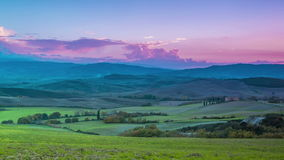 Evening over the fields and hills of Tuscany. Time lapse. Italy. Tuscany. The evening falls on fields and hills. Time lapse stock video