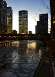 Evening over a frozen Chicago River in the loop during evening commute. Evening over a frozen Chicago River in the loop during evening commute on a January Royalty Free Stock Photography