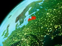 Latvia from space in evening. Evening over Latvia as seen from space on planet Earth. 3D illustration. Elements of this image furnished by NASA Stock Image