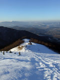 Evening over the mountains. A picture of snowy Carpathian mountains in the evening Stock Photo