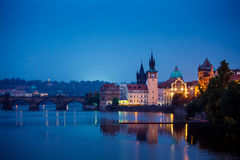 Evening over river Vltava near Charles bridge in Prague Royalty Free Stock Images