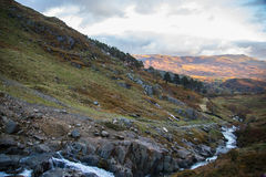 Evening over Snowdonia. River on Watkin Path Royalty Free Stock Photography